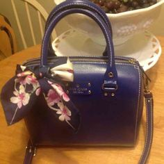 Kate Spade Wellesley Alessa Crossbody Holiday Blue This is a great cross body bag by Kate Spade. It's in great pre-owned condition with some indentations where the handles hit the bag and the leather shows very light wear, but overall, a beautiful little cross body. Nice size, and accessories look great on this bag.  kate spade Bags Crossbody Bags