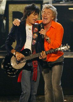 """Rod Stewart, right, and Ronnie Wood performed """"Maggie May"""" together at the 2004 """"Fashion Rocks"""" concert in New York City."""