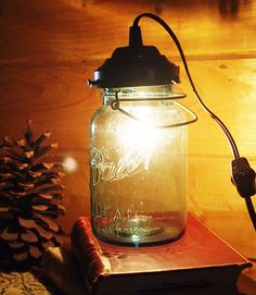 Transform a wire bail mason jar into a tableside lamp! You'll need some (surprisingly inexpensive) hardware supplies: a shade holder, bushing, candelabra socket, light bulb, and cord with clicker switch. Optional: spray paint and patience.  Get the tutorial at Resourceful Gals »  - GoodHousekeeping.com