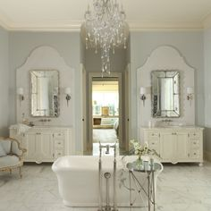 Beautiful marble slab behind the mirror.  That extra detail is stunning in this particular space.