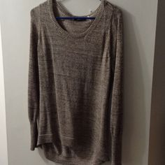 Gold glitter sweater Very pretty oversized sweater. Has gold glitter thread woven throughout. Sweaters