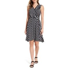 Women's Tommy Bahama Faux Wrap Jersey Dress ($158) ❤ liked on Polyvore featuring dresses, black, jersey dresses, stripe dresses, stretchy dresses, faux wrap dress and jersey wrap dress