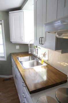 Simple Moments Kitchen Reno: Cabinet paint and butcher block counters