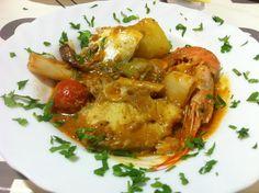 Romesco de peix amb calçots i perfum de cilantre
