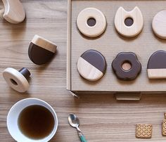"""""""""""Frolle"""", the series of coat hooks created by Italian designer Andrea Brugnera for Formabilio. Funny wall hooks that reflect the classic shapes of cream and chocolate cookies baked by granny, playful solutions entirely made in Italy, in solid wood with water-based paints. An alternative way to arrange and decorate the rooms with tasty creative details."""""""