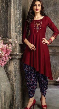 Beautiful asymmetric cotton kurti with beautiful embroidery motive .
