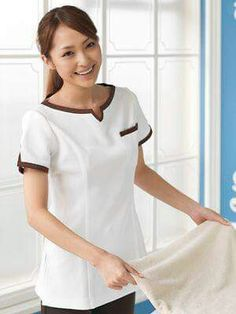 In a different color, I'd much rather have this than the slightly-too-deep-V-neck of traditional scrubs that show off everything every time I bend down Salon Uniform, Spa Uniform, Hotel Uniform, Scrubs Uniform, Maid Uniform, Uniform Dress, Medical Uniforms, Work Uniforms, Scrubs Outfit