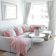 A grey and pink living room by @stylebysandra_