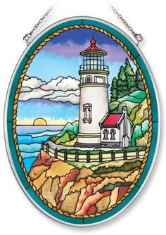 Amia Hand Painted Glass Suncatcher with Heceta Head Lighthouse Design, 5-1/4-Inch by 7-Inch Oval by Amia. $19.00. Includes chain. Handpainted glass. Comes boxed, makes for a great gift. Amia glass is a top selling line of handpainted glass decor. Known for tying in rich colors and excellent designs, Amia has a full line of handpainted glass pieces to satisfy your decor needs. Items in the line range from suncatchers, window decor panels, vases, votives and much more.