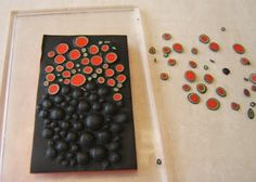 Polymer clay dots made by cutting off the tops of impressed colour layers- if only glass dots were so easy to make