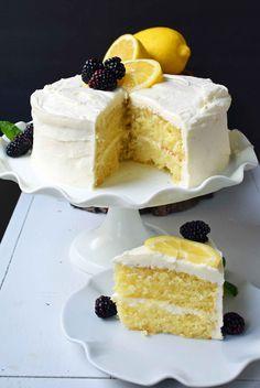 Italian Lemon Olive Oil Cake. Soft and tender moist lemon cake topped with lemon vanilla cream cheese frosting. The perfect lemon cake! www.modernhoney.com