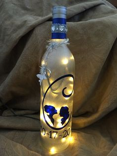 Frosted wedding lighted wine bottle