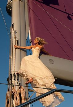 Angela Ismailos, the wife of shipping magnate George Economou, backed by a purple sail, on her dream boat, Baracuda. Photograph by Todd Eberle.