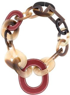 In Stores Now. Lacquered buffalo horn and dark red chamonix calfskin Hermès Isidore link necklace. Includes jewelry pouch.