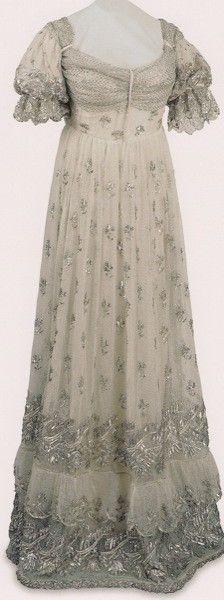 Court dress of Empress Josephine, after 1810  Gauze embroidered with silver. Height: 115 cm  Musée National du Château de Malmaison  © Photo RMN © Gérard Blot/Courtauld Exhibition archive.