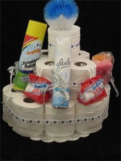 Toilet Paper Cakes make excellent gag gifts for a wedding, a bridal shower, a bachelorette party, etc. Each cake contains 15 rolls of Scott toilet paper, 1Toilet bowl cleaner,1 Can of air freshner,2 toilet bowl cleaners to sit on side of toilet,ribbon,cardboard for base. All wrapped and cutely decorated to fit any color scheme.