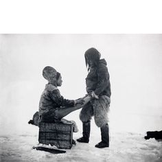 Foot Rub - An Inuit man warms his wife's feet Peterahwik Greenland c. 1880-1890. Photo by Robert E. Peary from Northway Over The Great Ice documenting Peary's expeditions. #inuit #footrub #greenland #expedition #robertepeary #natgeo by michielkeuper