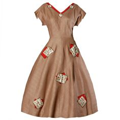1950s Linen Seed-Beaded Patchwork Dress with a Full Sweep   From a collection of rare vintage day dresses at https://www.1stdibs.com/fashion/clothing/day-dresses/