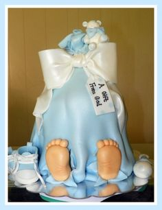 Bundle of Joy Cake...shoes,bow,rattle, bear and those sweet little feet are all made from fondant.