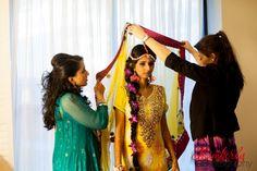 Mehndi night hair and makeup for Pakistani bride in a yellow anarkali #desi #weddingdecor #shaadibazaar