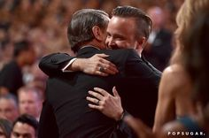 Pin for Later: Relive the Best Moments From the 2014 Emmys  Bryan Cranston and Aaron Paul shared a sweet embrace.