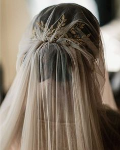Hair: There's a distinct other-worldly sense to this veil and comb combination. Comb by @jennmignonne, veil by @_emilyriggsbridal, photo by @mksadlerwed. #weddinghair #weddingveil #oncewedstyle
