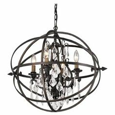 "Showcasing crystal drops and an openwork cage silhouette, this candelabra-inspired pendant brings a pop of visual interest to your foyer or dining room.  Product: Pendant Construction Material: Hand-worked wrought iron and crystalColor: Vintage bronzeFeatures: Openwork cage silhouetteAccommodates: (4) 60 Watt candelabra bulbs - not included Dimensions: 21"" H x 23.75"" W x 20.13"" D"