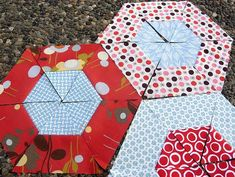 have you seen the hexagon quilt a long flickr pool??  lots of triangles getting cut!  here are a few...   Uploaded on April 11, 2010   by...