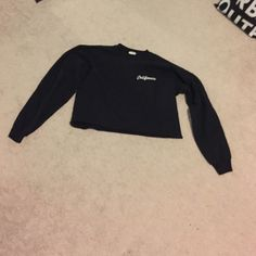 Black cropped sweatshirt Black long sleeve sweatshirt that is cropped. 27 inches from top to bottom. Worn once. Size small but will fit a medium PacSun Sweaters