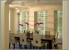 Love this dining room - and that's not wallpaper - it's a collection of mini liquor bottles! Shows how a bit of imagination can make something awkward to store into something to behold.