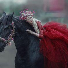 I was inspiring by Lady Chatterley's dream today☺❤ very romantic story I can say  photo, stylist, MUA, hair, editing @agnieszka_lorek / lovely model @mariaamanda_official / dress @gosiamotas  #agnieszkalorek #fantasy #fairy #fairytale #fairytail #elf #reddress #ladyinred #ladychatterleyslover #inspire #blondehair #flowersinmyhair #romantic #dreams #blackhorse #horses #animals #girl #instalove #shoot #danishgirl #poland