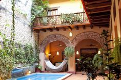 House in Cartagena, Colombia. If you're planning a wedding or simply going to Cartagena with a large group then this is the perfect place for you. Casa Catalina can accommodate 50 people comfortably.  Just a 10 minute walk to the beach and right in the heart of  the Walled Cit...