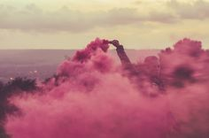 Coloured smoke bomb grenades portrait creative photography. Standing tall within the storm.