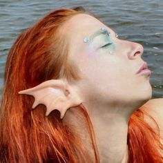 Pretty mermaid ears. I don't know why, but I've only seen a few different types of mermaid ears. Elf ears? Everywhere. Faun ears? No problem. Mermaid fin ears? Not really.