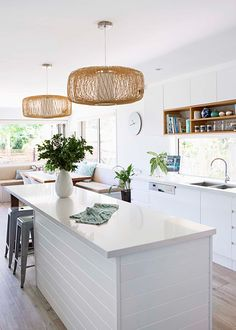 white on white kitchen, panelled island bench