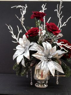 Silver and red Christmas floral arrangement at Michaels