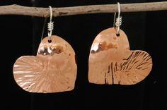 Shiny little copper Valentine heart earrings hung on Sterling silver 2516