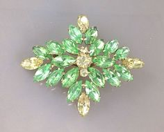 25% OFF CLEARANCE SALELarge Gorgeous Vintage Bright Apple Green Rhinestone Brooch with light yellow rhinestones. Sparkly Brooches. Juliana by TheOldJunkTrunk on Etsy https://www.etsy.com/listing/229789645/25-off-clearance-salelarge-gorgeous