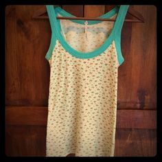 Free People tank Super soft waffle tank in mint green with small red flowers. Perfect condition. Free People Tops Tank Tops
