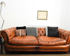 Sofas & Couch, What Is A Real Chesterfield Sofa With Pillows And Standing Lamp Gorgeous Pictures Of What Is A Chesterfield Sofa Designs: Gorgeous Pictures of What is a Chesterfield Sofa Designs