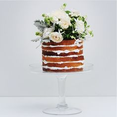 There is something magical about Flowers on an unstructured Wedding Cake! #inspiration