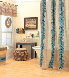 We've turned basic burlap into boutique-worthy creations. From the window treatment to the shower curtain and the lamp to the hamper, everything in this bathroom got the burlap treatment.