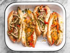 You don't need a grill to make these sweet and tangy Roasted Bratwurst with Peppers and Onions because the oven does all the work.