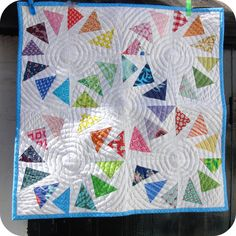great use of this block. love the quilting, too.