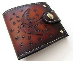 Men's Leather Sparrows Bifold Wallet. Made from high quality American saddle leather. Hand dyed in our signature brown sunburst. Hand sewn in contrasting ivory thread. Hand tooled sparrow with stars on front and back of wallet. Optional snap closure for extra security. 4 credit card slots that will easily fit 12 cards (full pockets, not just slots). Large money flap that makes it easy to get to your cash. Measures 4.25 inches by 3.5 inches (11 cm by 9 cm) closed. We offer free...