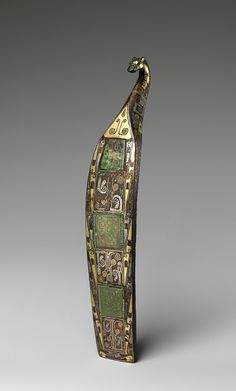 Belt hook - Eastern Zhou dynasty, Warring States period (475–221 B.C.) Date: 5th–3rd century B.C. Bronze with gold and silver inlay inset with nephrite.