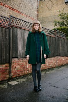 green coat, tartan dress, slipper, mocassim, oxford, blonde girl, vintage glasses