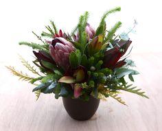 wedding reception table centrepiece protea, leucadendron, brunia, grevilliea, eucalyptus