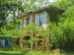 By far the largest and most elaborate home in tiny Liberty, Kansas, this structure has been abandoned and boarded up. It makes me wonder, why?
