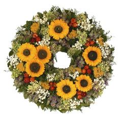 """Summer Sunflower Premium Dried Floral Wreath- (22""""). Find artificial flowers and christmas trees at Target.com! Bring the fresh feeling of summer indoors with this summer sunflower dried floral wreath. Made with preserved sunflowers, hydrangea, lavender ammobium, yarrow, mint flower, safflower, caspia and natural leaves, this gorgeous wreath is built on a natural twig base. Each wreath is made upon receipt of the order, so you'll have a fresh, flawless wreath to enhance the decor of any…"""